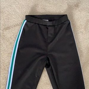 Black legging/joggers with white and green stripe